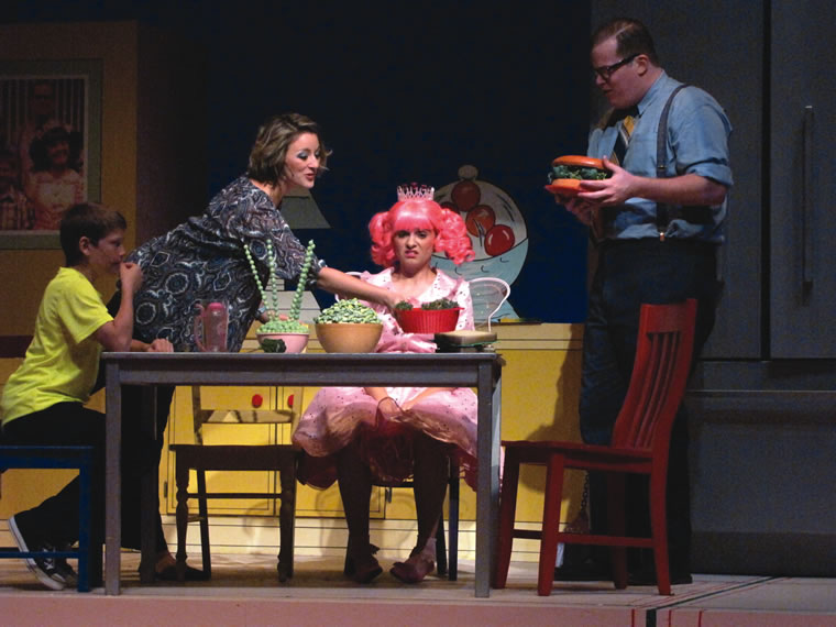 "In the youth theater production ""Pinkalicious The Musical,"" the lead character catches ""pinkititis"" and turns pink from head to toe."