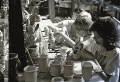 In July 1977, local artist Douglas Miller snapped a shot of customers glazing mugs at John and Jan Alabaster's Sawdust Art Festival booth. | Photo by Douglas Miller