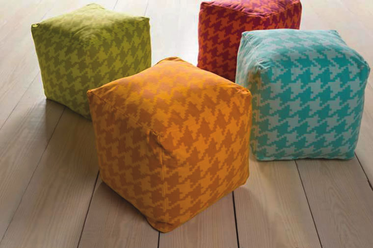 These colorful poufs from Tuvalu Home Environment provide convenient additional seats when entertaining.