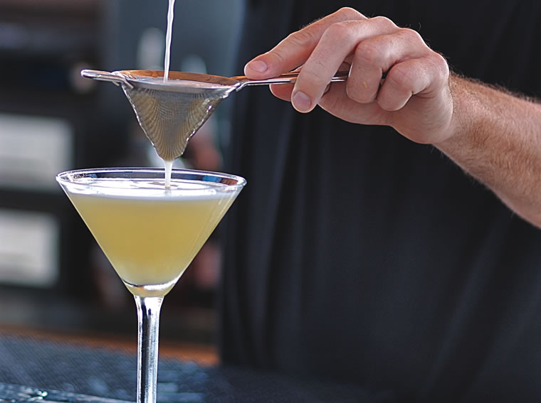 Mozambique Bartender Pouring Durban Pie Martini-CROPPED