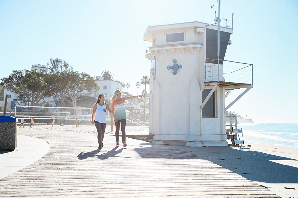 Janelle Naess (right) curates a variety of self-guided, local walking tours through Laguna Beach Walks.