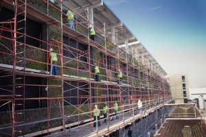 Crews create a living wall on the Edwards Lifesciences parking structure in Irvine.