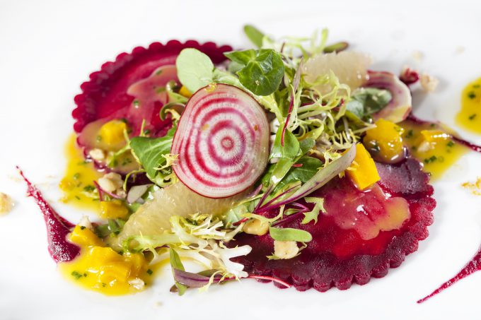 Pops of color come from vegetables in the scarlet beet ravioli.