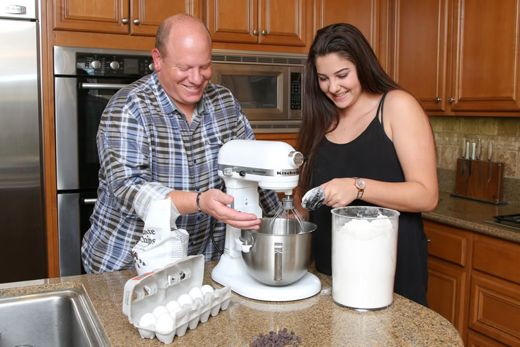 Marc Cohen and his daughter Sydney prepare a cake from a recipe that originated with his grandmother.