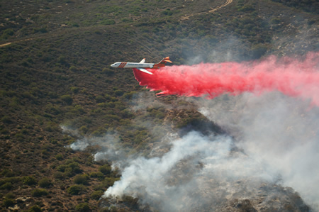 Emergency responders work to put out the canyon fire in July 2015. | Photo by Greg Farnes