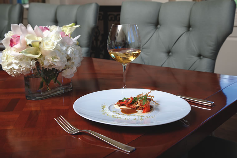 An oaked chardonnay, like a classic Meursault, complements Studio's butter-poached lobster.