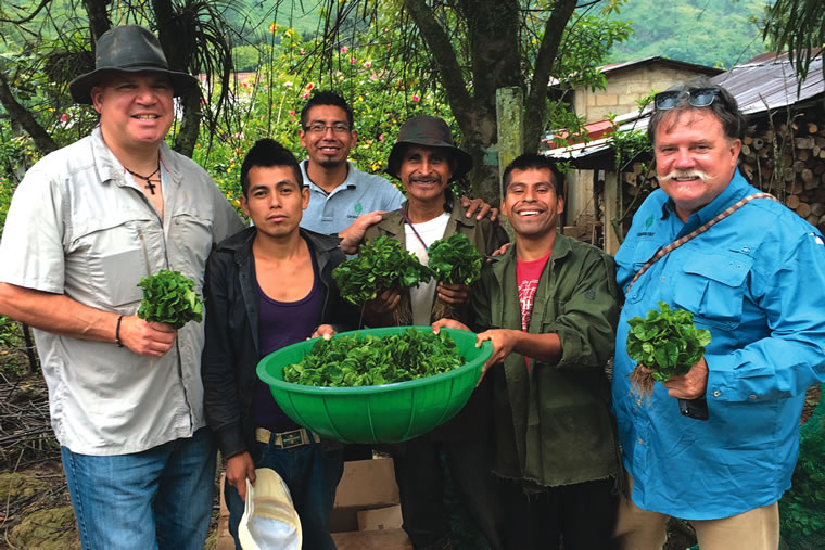 Andrew Vournas (left) and Dave Day (right) distribute coffee seedlings in Oaxaca, Mexico.