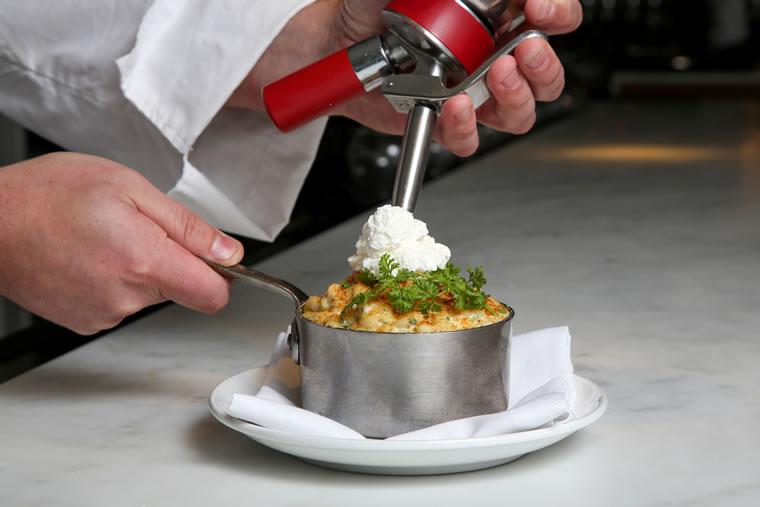 Selanne Steak Tavern tops its version with Parmesan foam.