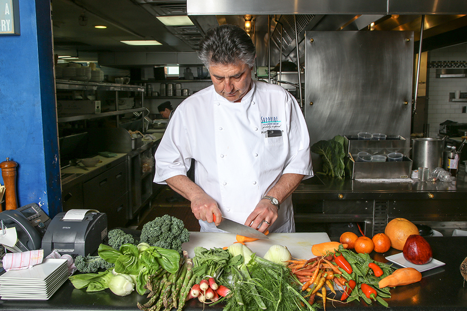 Sapphire Laguna chef-owner Azmin Ghahreman cooks with a variety of fresh, colorful produce.