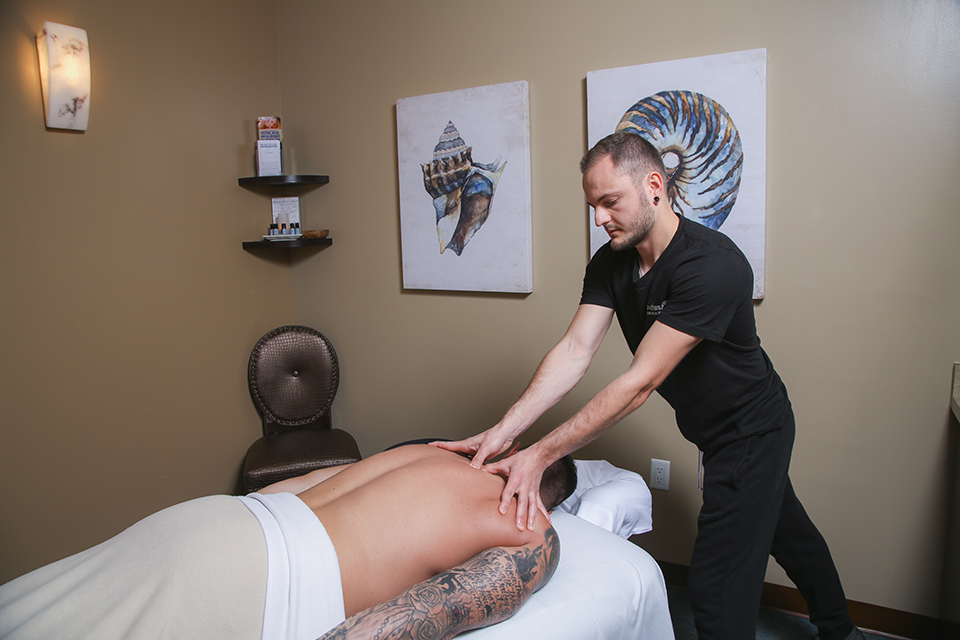 Hand & Stone Massage offers sports massage to target sore muscles. (Photo by Jody Tiongco)