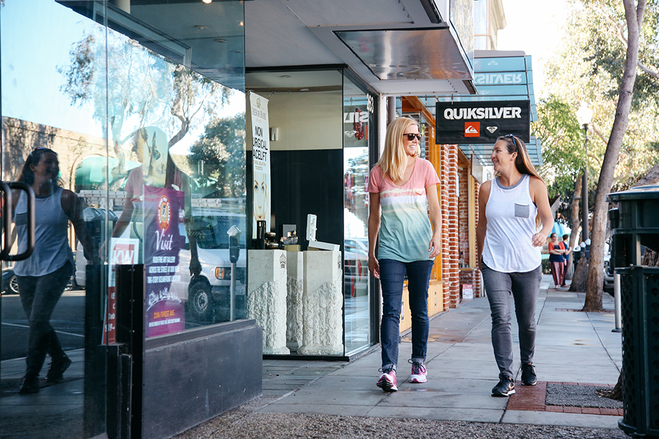 Janelle (left) creates walking tours for those who want to improve their health while enjoying Laguna's scenery.